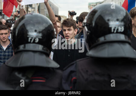 Moscow, Russia. 12th June, 2017. Protestors face police officers in an opposition rally in Moscow, Russia, on June - Stock Photo