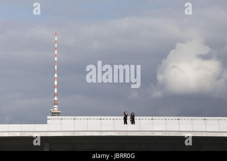 Berlin, Germany. 12th June, 2017. Two German policemen are seen at an observation post on the roof of the Paul-Löbe - Stock Photo