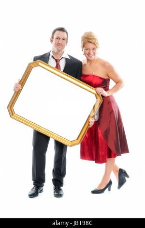 enamoured couple holding frame - Stock Photo