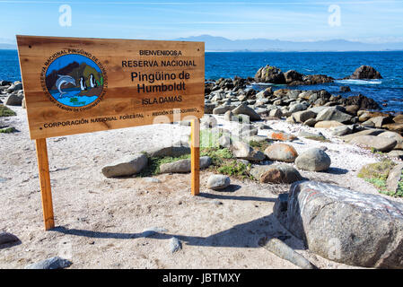 Sign for the Humbolt Pinguin National Reserve in Chile - Stock Photo
