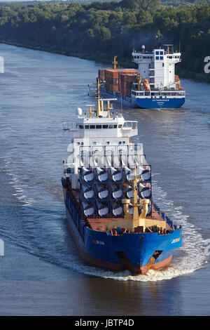 The container vessels Astrorunner and Berum loaded with rotor blades for wind turbines at the Kiel Canal near Beldorf - Stock Photo