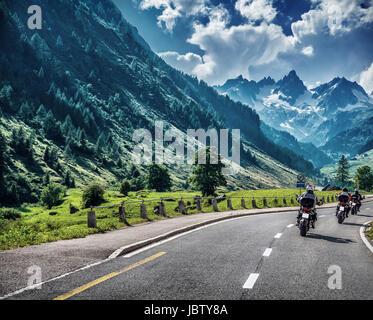Motorcyclists on mountainous road, enjoying tour along Alps, summertime activities, wonderful mountain landscape, - Stock Photo