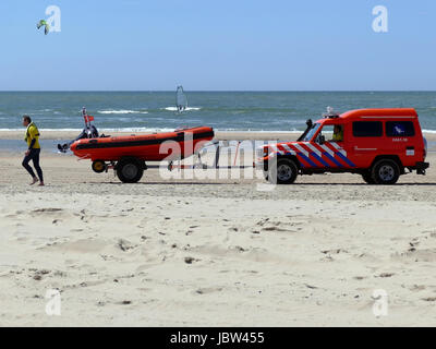 CASTRICUM, THE NETHERLANDS - JUNE 10, 2017: Speedboat, surf life saving vehicle and crew on the beach of the Dutch - Stock Photo