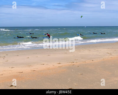 CASTRICUM, THE NETHERLANDS - JUNE 10, 2017: Young teenagers having fun with surfing lessons - Stock Photo