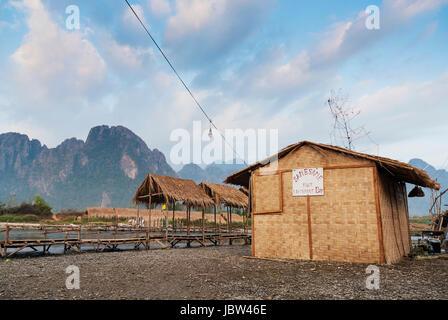 riverside bars and karst landscape in vang vieng laos - Stock Photo