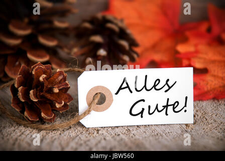 The German Words Alles Gute, which means Congratulations on a Label as Fall Background - Stock Photo