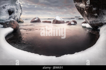 Scenic landscape with sea and lovely morning light at winter time - Stock Photo