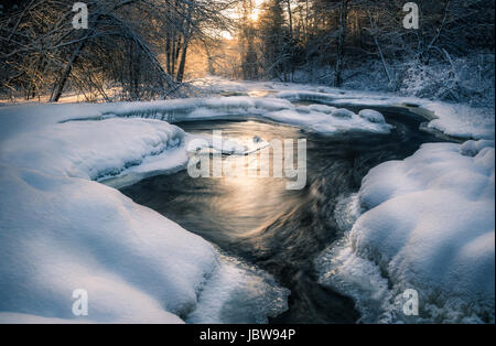 Scenic landscape with flowing river at winter morning - Stock Photo