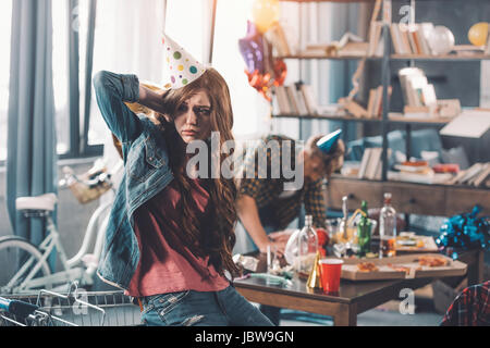 Cleaning Messy Room man with hangover cleaning messy room after party stock photo