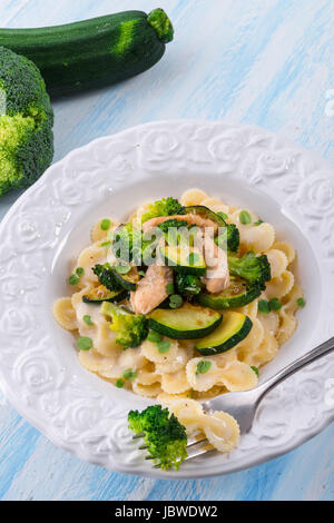 Farfalle pasta with zucchini and broccoli Stock Photo ...