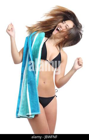 Teenage girl wearing bikini, jumping, mid air, on beach ...