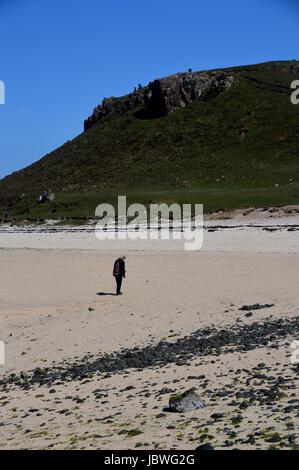 Lone Woman Wallking on Coral Beach near Claigan, Dunvagan, Isle of Skye,Scotland UK - Stock Photo
