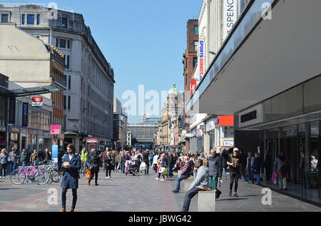 GLASGOW, SCOTLAND - 3 MAY 2017: A pedestrianised shopping area of Argylle Street with the glass walled railway bridge, - Stock Photo