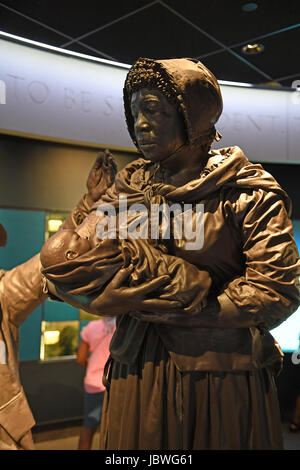 Memphis, TN, USA - June 9, 2017: Sculpture display of black slavewoman and child at the National Civil Rights Museum and the site of the Assassination