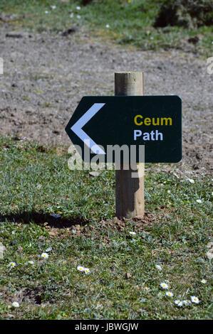Green Wooden Footpath Sign in Gaelic & English near Coral Beach, Claigan, Dunvagan, Isle of Skye,Scotland UK - Stock Photo