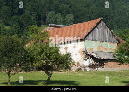 Farmhouse in rural Romania - Stock Photo