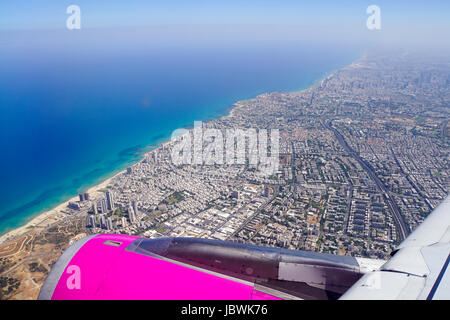 Elevated view of Tel Aviv and Bat Yam as seen from a departing plane window - Stock Photo