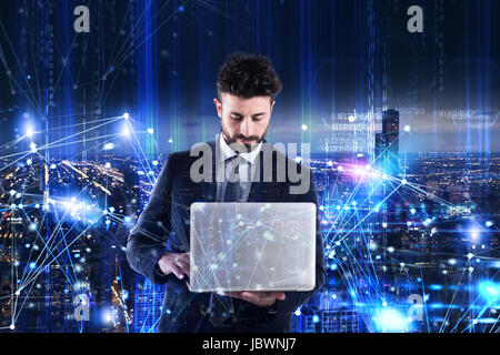 Man working on a laptop. Concept of software analysis - Stock Photo