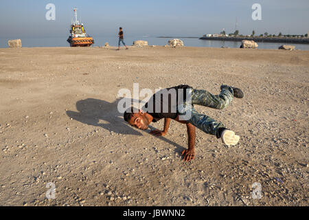 Bandar Abbas, Hormozgan Province, Iran - 16 april, 2017: The Iranian young man shows a figure, a breakdance on the - Stock Photo