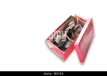 A pair of old brown woman shoes in a red box isolated on white background. - Stock Photo