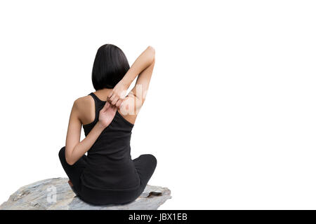 Close-up back of feminine and holding the hands together and crossed legs during meditation isolated on white background. - Stock Photo