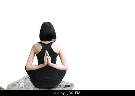 Close-up back of feminine and press the hands together and crossed legs during meditation isolated on white background. - Stock Photo