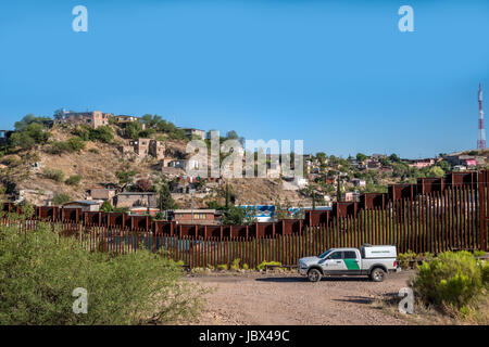 Border patrol in front of fence dividing USA and Mexico in Nogales, Arizona, USA; a matter of current politics and - Stock Photo
