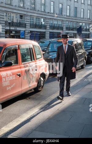 Formaly dressed hotel porter on Regents Street,London,England - Stock Photo