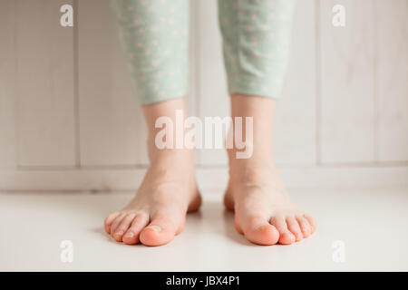 Bare feet of a girl tired of uncomfortable shoes, close-up. - Stock Photo