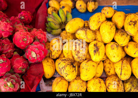 Mangoes and dragon fruits at the market stall in Chiang Mai, Thailand. - Stock Photo