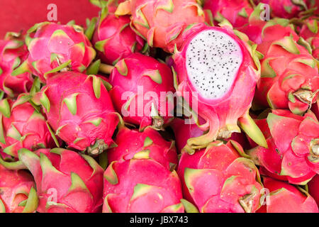 Dragon fruits at the market stall in Chiang Mai, Thailand. - Stock Photo