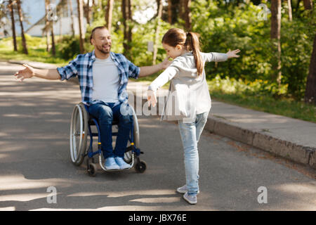 Enigmatical girl standing opposite her daddy - Stock Photo