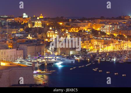 Aerial view of Birgu from Valletta at night, Malta - Stock Photo