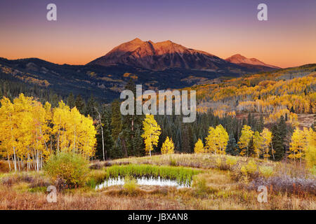 East Beckwith Mountain at sunrise near Kebler Pass in West Elk Mountains, Colorado, USA - Stock Photo