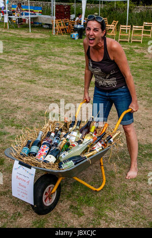 A Woman Wins The 'Barrow of Booze' At The Jevington Fete, Eastbourne, Sussex, UK - Stock Photo