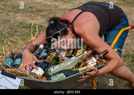 An Excited Woman Wins The 'Barrow of Booze' At The Jevington Fete, Eastbourne, Sussex, UK - Stock Photo