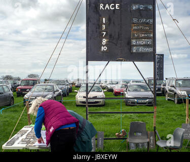 official notice board  showing runners and riders at Eggesford hunt point to point  riders are amature, horses qualify - Stock Photo