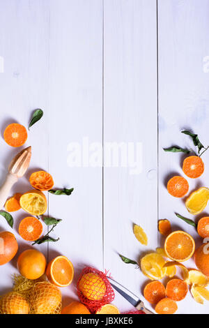 Oranges, ripe fruits freshly picked on a white wooden table, copy space, top view. - Stock Photo