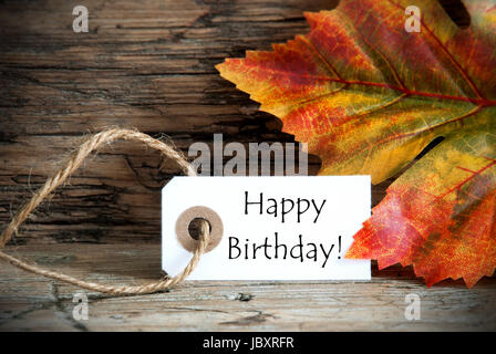 Autumn Label with the Words Happy Birthday on it - Stock Photo