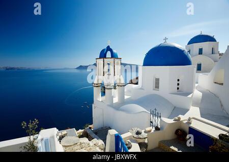 Churches overlooking Oia, Santorini - Stock Photo