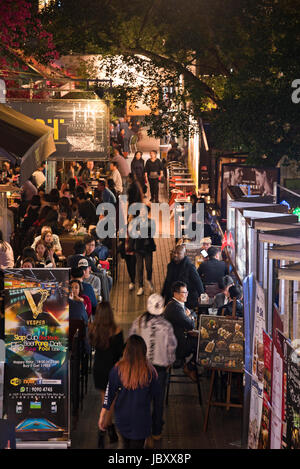Vertical aerial view of people on Knutsford terrace in Hong Kong, China. - Stock Photo