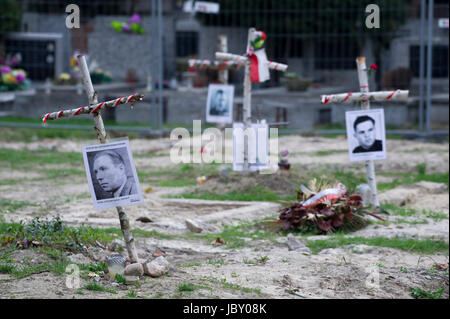 Crosses with pictures of Cursed soldiers (Zolnierze Wykleci) in Quater L (Kwatera Laczka) where are mass graves - Stock Photo