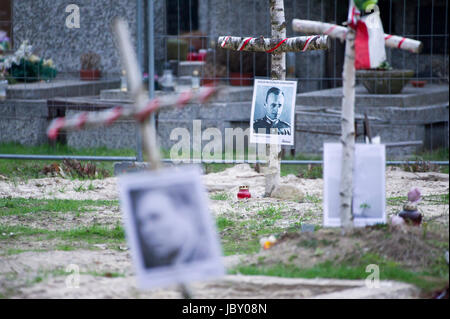 Picture of Witold Pilecki among crosses with pictures of Cursed soldiers (Zolnierze Wykleci) in Quater L (Kwatera - Stock Photo