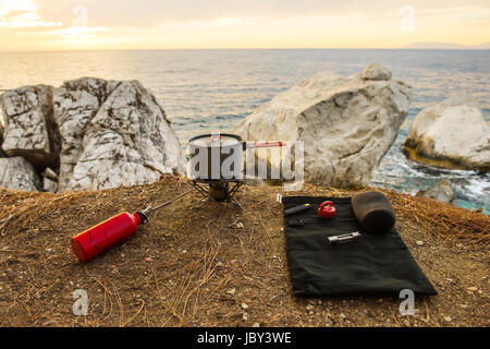 Tourist equipment and tools: camping gas over sea background - Stock Photo