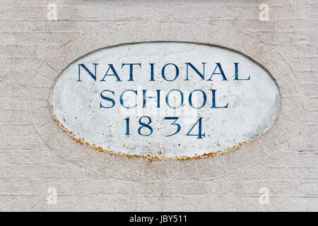 National school building 1834, commemorative plaque, Bosham, a coastal village on the south coast near Chichester, - Stock Photo