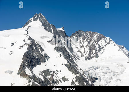 The peak of the Grossglockner, the highest mountain of Austria - Stock Photo
