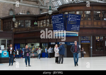 Glasgow Central Station with a cardboard cutout police officer top left - Stock Photo