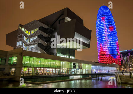 The Torre Agbar , Barcelona, lite up at night in stunning colours. - Stock Photo