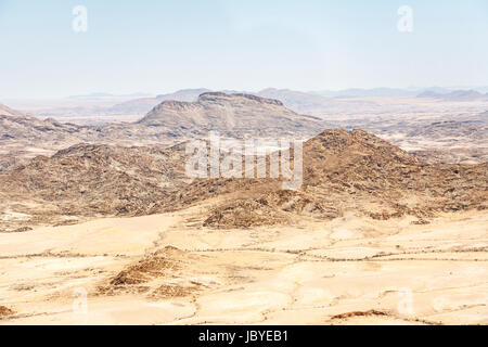 Typical bleak, arid mountainous terrain of the Namib Desert on the Skeleton Coast, Namibia, south-west Africa - Stock Photo