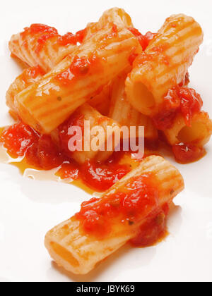 close up of maccheroni pasta in tomato sauce - Stock Photo